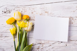 Easter and spring flat lay on a white wooden background. Copy space.