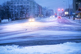 Prague city street under the snow. Cars driving on a blizzard road. Snow calamity in the city.  Snow covered cars. Winter - 197051441