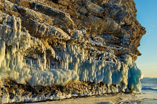 Fotobehang Grijze traf. Russia. Eastern Siberia, lake Baikal. The icy cliffs of the island of Olkhon.