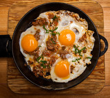 Fried eggs for breakfast. Pan of fried eggs with bacon. English breakfast