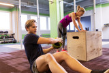 woman and man with medicine ball exercising in gym