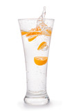 Glass of water with orange fruit slices and splash isolated with clipping path