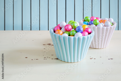 Easter candies or chewing gum in decorative dishes.