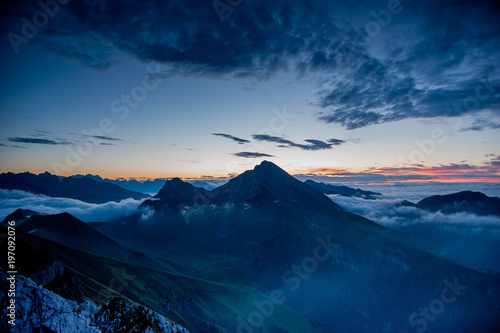 Fotobehang Nachtblauw Dawn in the mountains with fog