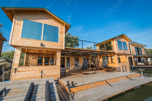 Exterior of luxury wooden cotagge next to river - 197115623