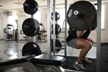Athlete Doing Exercise For Legs With Barbell © Jale Ibrak