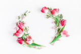 Flowers composition. Wreath made of pink tulip flowers on white background. Flat lay, top view, copy space