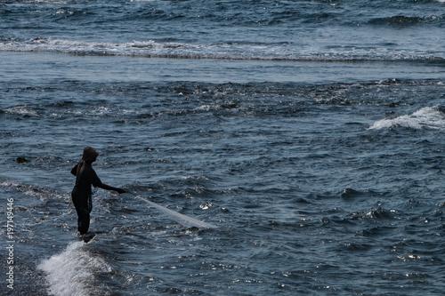 Keuken foto achterwand Bali A Balinese fisherman pulling in his net