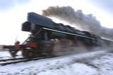 blurred steam locomotive in motion - 197162658