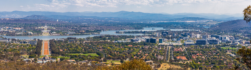 View of Canberra from Mount Ainslie lookout - ANZAC Parade leading up to the Parliament and modern architecture. ACT, Australia