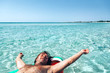 Man on lilo on the beach