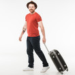 Portrait of stylish male tourist carrying suitcase isolated on white, travel concept