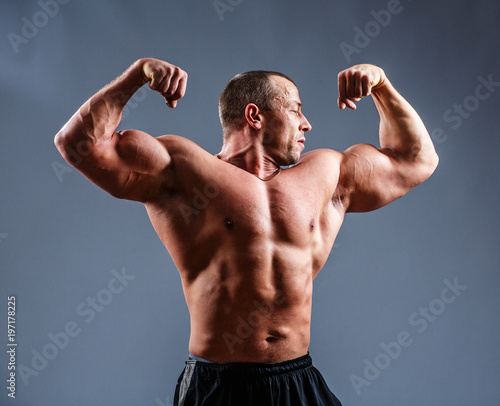 Portrait of muscle man posing in studio.