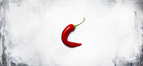Fotobehang Hot chili peppers Red hot chili pepper on a gray background, minimalistic style, top view