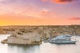 Sunrise over Birgu and Grand Harbor in Malta