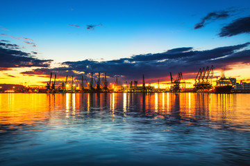 Sunset over sea port and industrial cranes, Varna