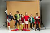 Group of happy children show different sport. Studio fashion concept. Emotions concept.