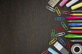 Colorful pencils, pens, stationery supplies on wooden background - 197205075