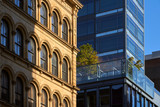 Soho building facades with contrasting architectural styles. New York City, Manhattan, Soho - 197207467