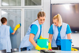Commercial cleaning crew ladies working as team in office - 197214618