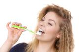 Woman brushing cleaning teeth - 197221430
