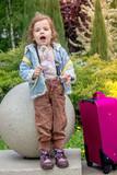 Little girl kid blow dandelion