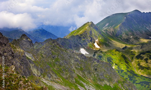 Poland, Tatra Mountains, Zakopane - Dolina Pieciu Stawow Valley, Zadni Staw Pond, Kotelnica, Gladki, Walentkowy peaks, Gladka and Walentkowa Pass with High Tatra mountain range panorama in background