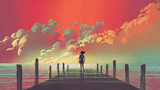 beautiful scenery of the woman standing alone on a wooden pier looking at colorful clouds in the sky, digital art style, illustration painting - 197268637