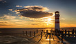 Lighthouse view during winter and dramatic sunset, Podersdorf am see, Austria