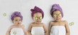 Leinwanddruck Bild - Funny baby girl and kids in white towels and terry cloth bath turbans with cucumber face treatments