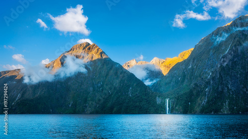 Milford Sound wild beauty with its spectacular cliffs, rain forests and waterfalls in New Zealand. - 197294424