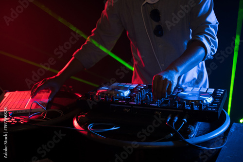 DJ playing turntable music on night club party - 197296828