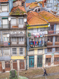 Drying clothes on the balcony of old houses