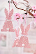 easter decoration with paper rabbits hanging on willow branch