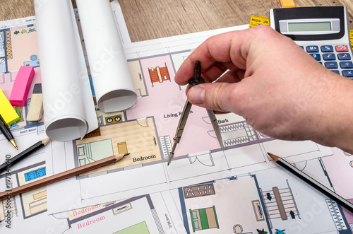 Architect reviewing and showing blueprint. architecture sketch.
