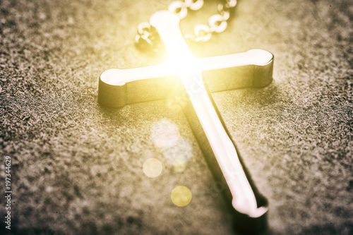 Silver cross on a gray background - 197344629