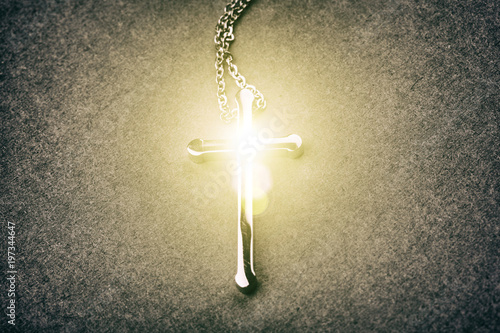 Silver cross on a gray background - 197344647