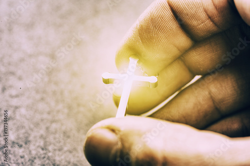 Silver cross in a hand - 197344656