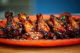 Caramelized chicken wings in closeup - 197347654