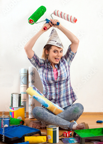 Repair home woman holding paint roller for wallpaper. Aggressive screaming girl in newspaper cap renovation apartment on isolated. Tired of work as student. Loan for housing for family.