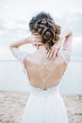 Young pretty woman in elegant dress. Back view bridal fashion background. Monochrome.
