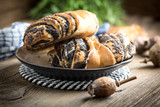 Sweet buns with poppy seed and frosting. - 197362269