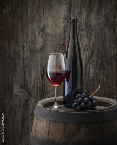 still life with red wine on old wood background