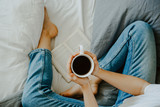 woman drinking tea in bed - 197366465