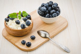 breakfast with cottage cheese and blueberry on a wooden tray/breakfast with cottage cheese and blueberry on a wooden tray. selective focus - 197375687