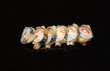 sushi on black glass