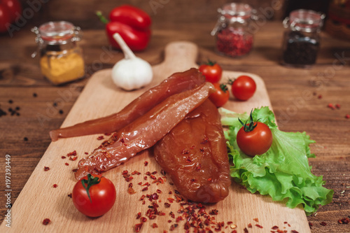 sausage on a wooden background - 197393449
