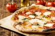 Quadro Neapolitan Style Pizza with buffalo mozzarella, tomato sauce and fresh basil