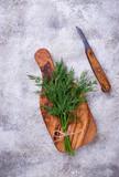 Fresh dill on cutting board - 197399428