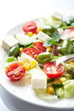 Mediterranean-style Salad with Green Olives, Feta Cheese, Cucumber, Cherry Tomatoes and Capers. White background. - 197402444